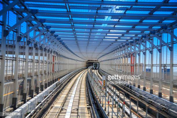 tram entering the tunnel - monorail stock pictures, royalty-free photos & images