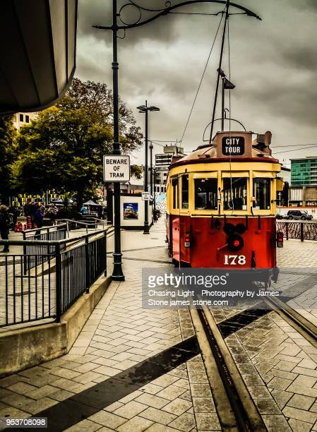 a tram in downtown christchurch - christchurch new zealand stock pictures, royalty-free photos & images