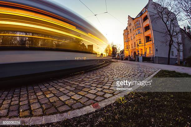 Tram in motion with yellow light stream