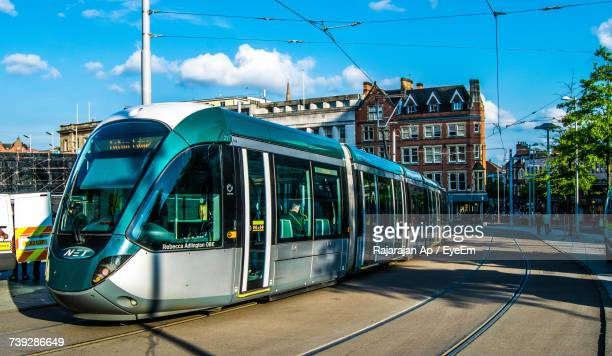 tram in the city - nottingham stock photos and pictures
