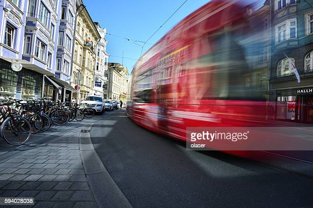 tram in the city traffic, rush hour - innsbruck stock pictures, royalty-free photos & images