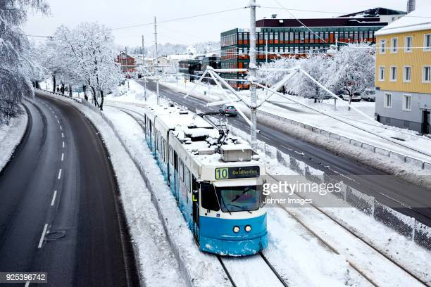 tram in winter - tram stockfoto's en -beelden