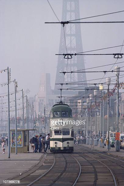 A tram makes it's way along the seafront in the seaside resort of Blackpool Lancashire August 1983