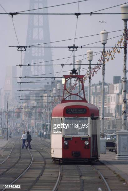 A tram makes its way along the seafront in the seaside resort of Blackpool Lancashire August 1983