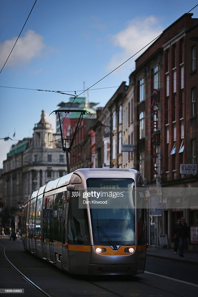 A tram makes it's way through Dublin city centre on October 23, 2013 in Dublin, Ireland. Dublin is the capital city of The Republic of Ireland situated in the province of Leinster at the mouth of the River Liffey. The greater Dublin area has a population of around 1.5 Million people.