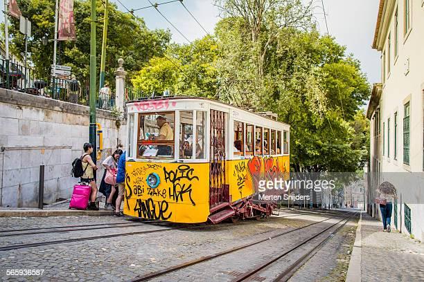 tram on calçada da glória - calçada stock pictures, royalty-free photos & images
