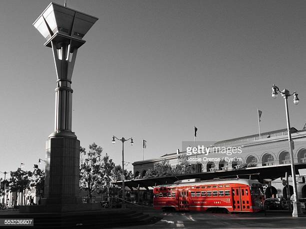 tram on city street against clear sky - isolated color stock pictures, royalty-free photos & images