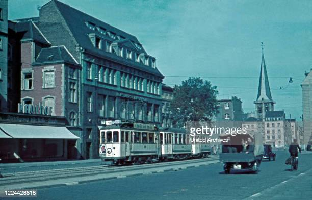 Tram on Pipinstrasse street corner Hohe Strasse street with St. Martin's church at the city centre of Cologne, Germany 1930s.