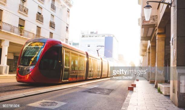 tram on street in city against sky - casablanca photos et images de collection