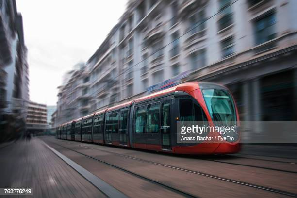 tram on street in city - railroad stock pictures, royalty-free photos & images