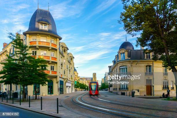 tram on the streets and architecture of reims a city in the champagne-ardenne region of france. - reims stock pictures, royalty-free photos & images