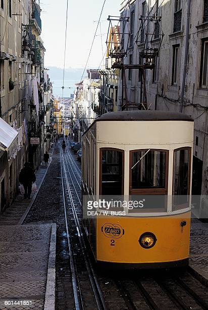 A tram on the streets in the Alfama neighbourhood Lisbon Portugal