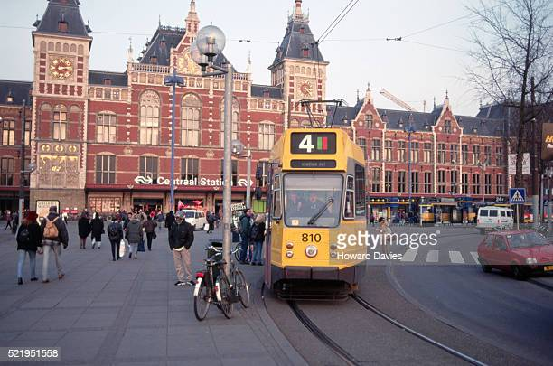 tram outside amsterdam's central station - tram stockfoto's en -beelden