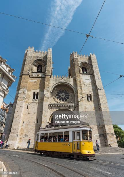 Tram passes by Lisbon Cathedral Portugal