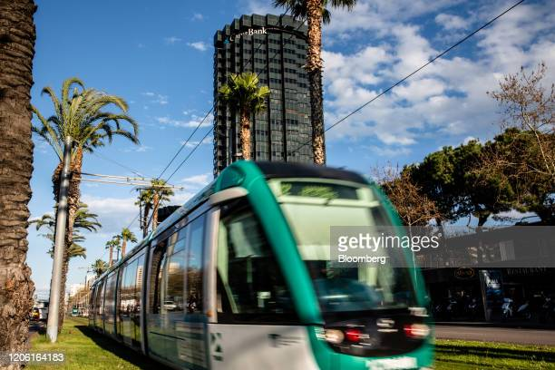 A tram passes by the headquarters of CaixaBank SA in Barcelona Spain on Thursday March 5 2020 Spanish bank shares soared after the European Unions...