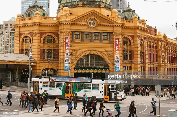 A tram passes Flinders Street Station on August 14 2012 in Melbourne Australia Melbourne has been crowned the most liveable city according to the...
