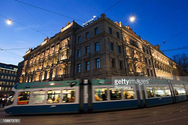 A tram passes the Credit Suisse Group AG company headquarters in Zurich Switzerland on Saturday Feb 5 2011 Credit Suisse Group AG Switzerland's...