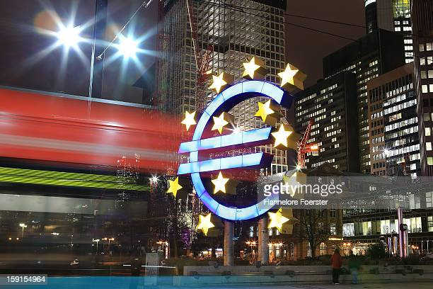 Tram passes the giant Euro symbol outside the headquarters of the European Central Bank on January 8, 2013 in Frankfurt am Main, Germany. The...