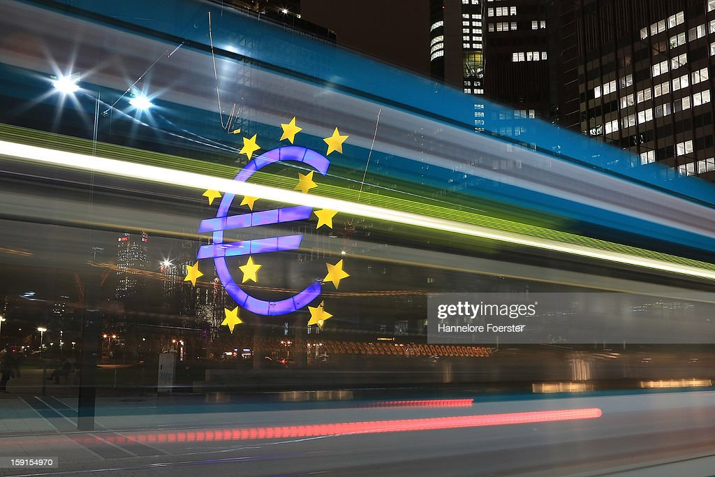 A tram passes the giant Euro symbol outside the headquarters of the European Central Bank (ECB) on January 8, 2013 in Frankfurt am Main, Germany. The governing board of the ECB is scheduled to meet this coming Thursday and analysts are predicting the bank will keep its interest rates steady.