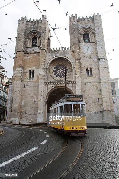 A tram passes the Lisbon Cathedral Santa Maria Maior de Lisboa in Lisbon Portugal on Sunday March 7 2010 The Portuguese government may reduce some...