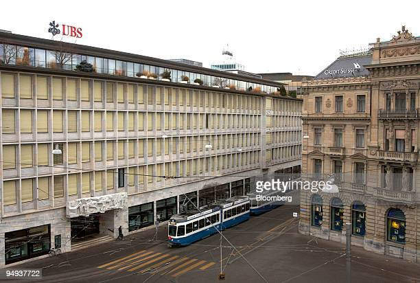A tram passes the UBS AG left and Credit Suisse Group AG headquarters in Zurich Switzerland on Saturday Feb 7 2009 Credit Suisse Group AG the biggest...