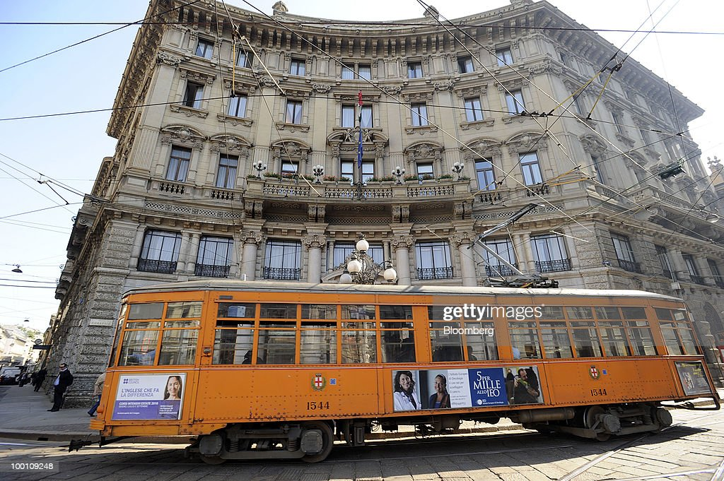 A tram passes the UniCredit SpA headquarters in Milan, Italy, on Friday, May 21, 2010. UniCredit SpA Chief Executive Officer Alessandro Profumo said that contagion from Greece's debt crisis will be managed and that Europe should concentrate on growth and not just cutting public debt. Photographer: Giuseppe Aresu/Bloomberg via Getty Images