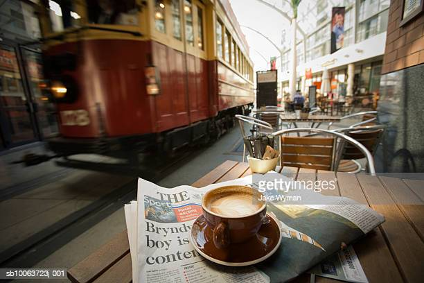 tram passing by outdoor restaurant - christchurch new zealand stock pictures, royalty-free photos & images