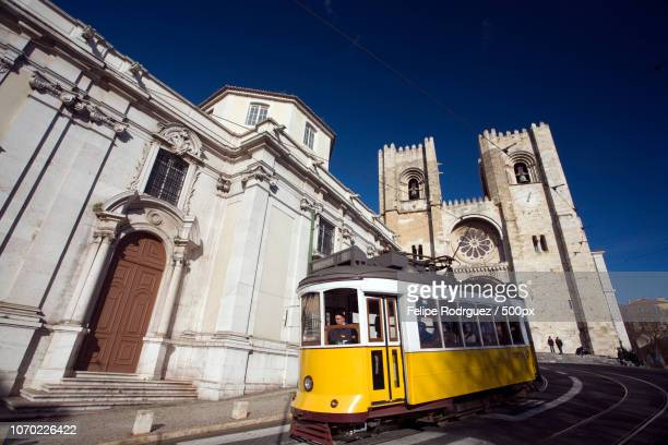 A tram passing in front of San Antonio de Lisboa church and Lisbon cathedral