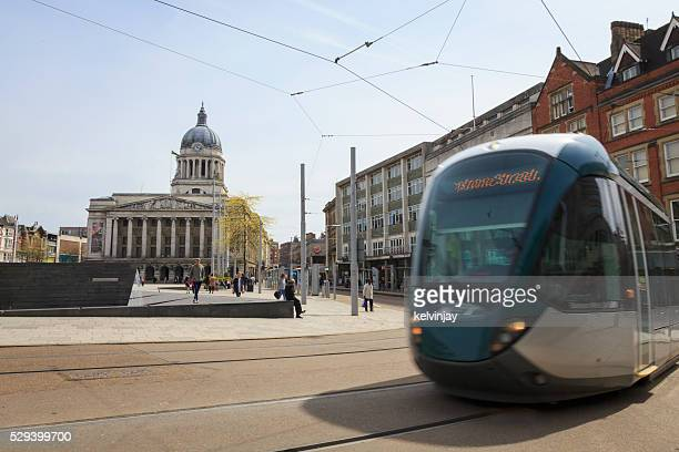 tram passing nottingham council house in the old market square - nottingham stock photos and pictures