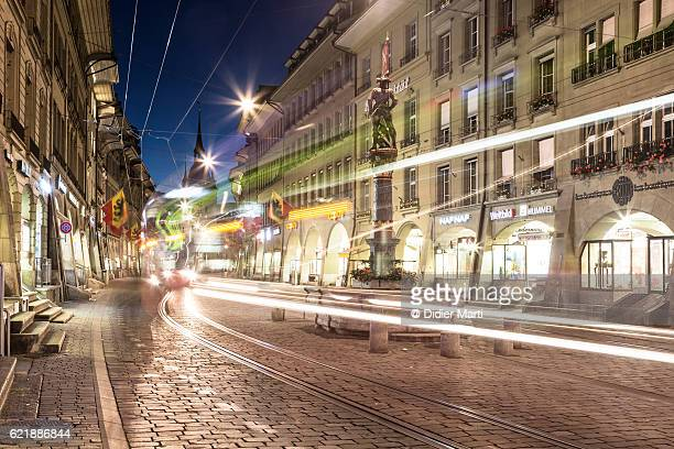 Tram rushing at night in Bern, Switzerland capital city