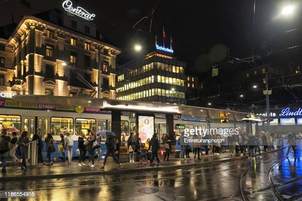 tram station at rush hour in downtown zurich. - emreturanphoto stock pictures, royalty-free photos & images