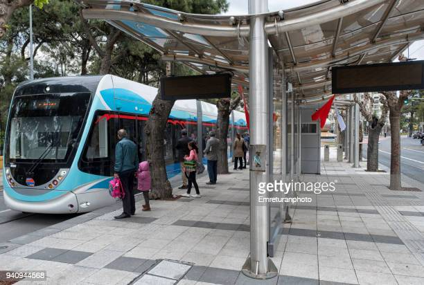tram station with passengers in izmir. - emreturanphoto stock pictures, royalty-free photos & images