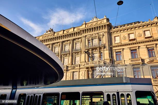 tram stop and credit suisse headquarters, paradeplatz, zurich - credit suisse stock pictures, royalty-free photos & images