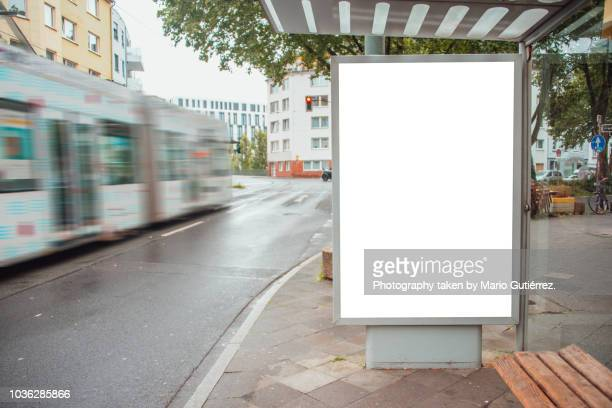 tram stop with billboard - vertikal stock-fotos und bilder