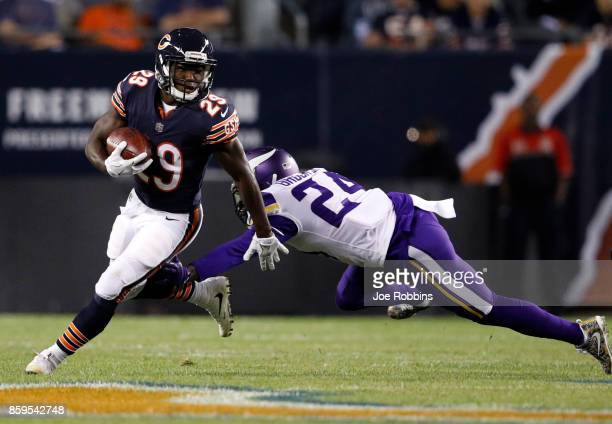 Tramaine Brock of the Minnesota Vikings attempts to tackle Tarik Cohen of the Chicago Bears in the first quarter at Soldier Field on October 9 2017...