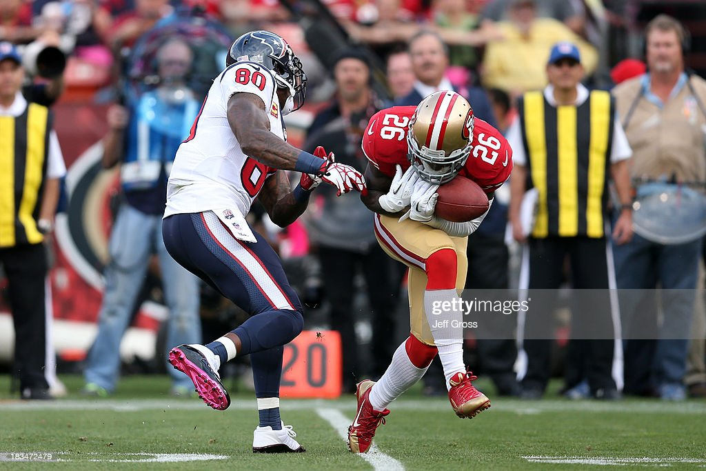 Tramaine Brock #26 of the San Francisco 49ers intercepts a pass to score a touchdown against Matt Schaub #8 of the Houston Texans in the first quarter during their game at Candlestick Park on October 6, 2013 in San Francisco, California.