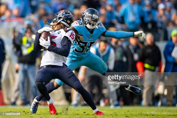 Tramaine Brock of the Tennessee Titans is penalized for a face mask as he tackles Will Fuller of the Houston Texans during the second quarter at...