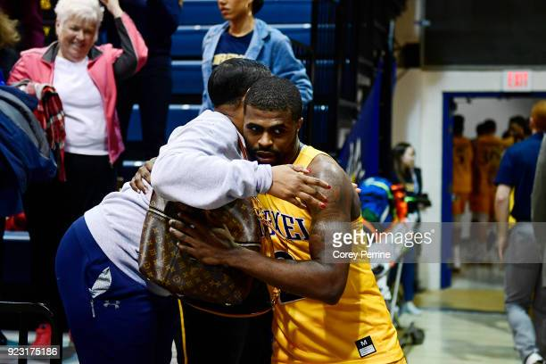 Tramaine Isabell of the Drexel Dragons hugs his mother Aiyana Brown of Seattle Washington after the game at the Daskalakis Athletic Center on...