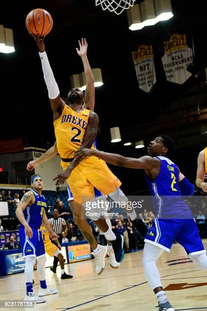 Tramaine Isabell of the Drexel Dragons picks up the basket and the foul Ryan Allen of the Delaware Fightin Blue Hens during the second half at the...