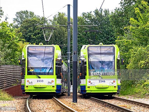 tramlink trams pass near the junction at sandilands - tram stock photos and pictures