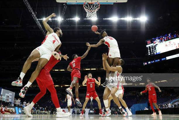 Tramon Mark of the Houston Cougars battles for the ball with Montez Mathis of the Rutgers Scarlet Knights during the second half in the second round...