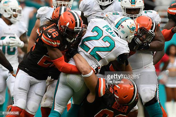 Tramon Williams of the Cleveland Browns and Jamie Meder tackle Isaiah Pead of the Miami Dolphins during the 3rd quarter of the game on September 25...