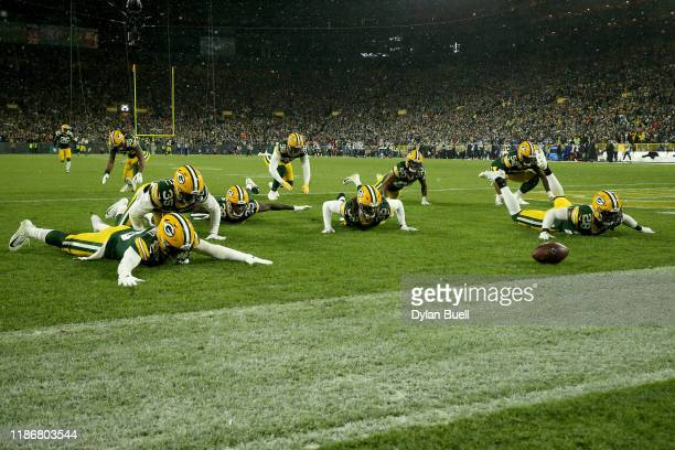 Tramon Williams of the Green Bay Packers celebrates with his teammates after an interception against Kyle Allen of the Carolina Panthers during the...