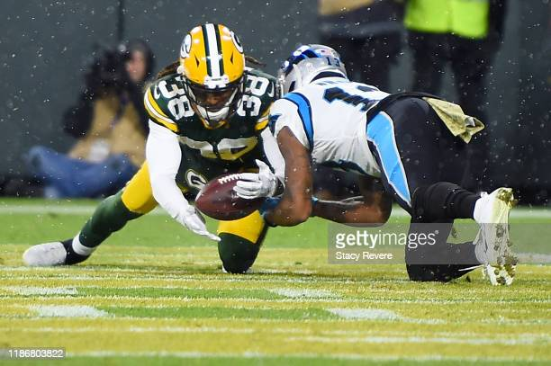 Tramon Williams of the Green Bay Packers intercepts a ball intended for Jarius Wright of the Carolina Panthers during the third quarter in the game...
