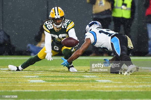 Tramon Williams of the Green Bay Packers intercepts a pass intended for Jarius Wright of the Carolina Panthers during a game at Lambeau Field on...