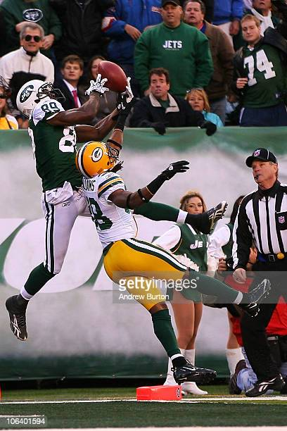 Tramon Williams of the Green Bay Packers keeps Jerricho Cotchery of the New York Jets from catching a pass in the end zone during the fourth quarter...