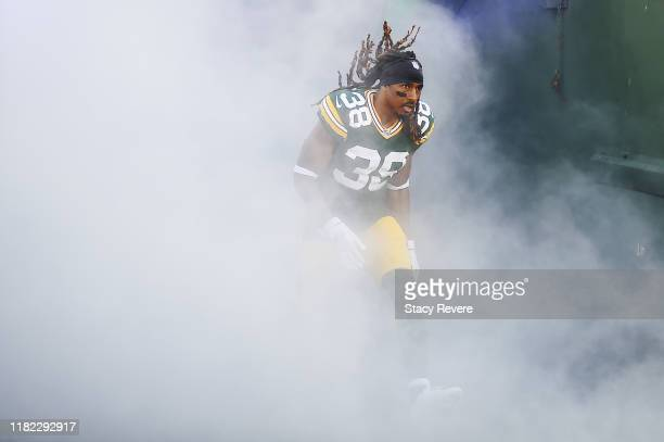 Tramon Williams of the Green Bay Packers runs onto the field as he is introduced prior to the game against the Oakland Raiders at Lambeau Field on...