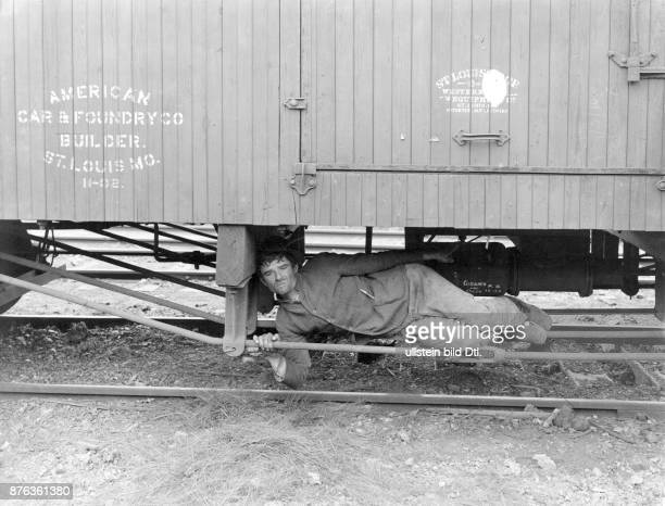 Tramp under a train Brown Brothers