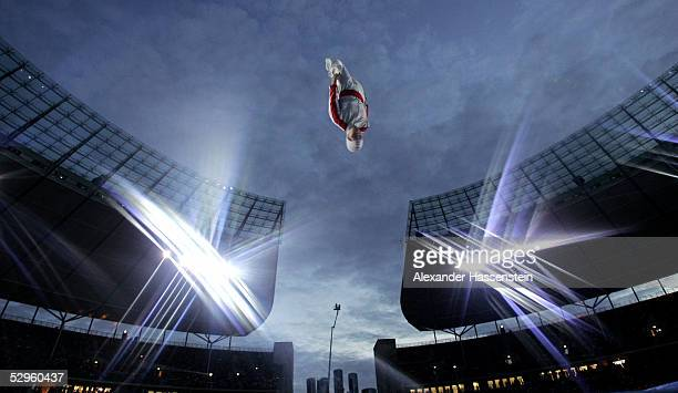 A trampoline jumper performs at the international German gymnastics festival stadium gala on May 20 2005 in Berlin Germany