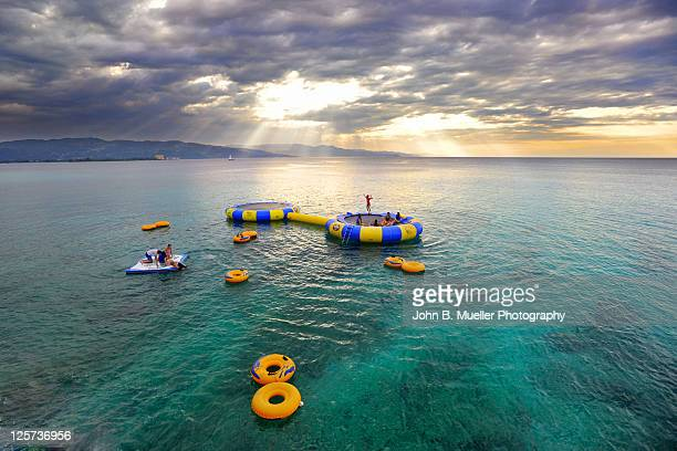 trampolines at sunset - montego bay stock pictures, royalty-free photos & images